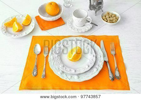 Table setting with orange napkin