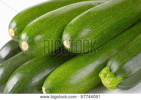 detail of fresh courgettes on white background