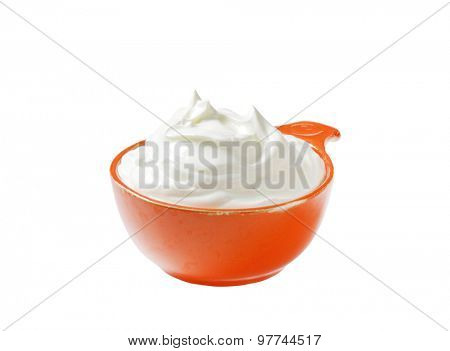 creme fraiche in an orange bowl isolated on white