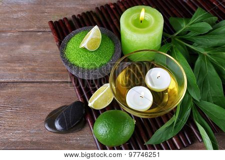 Spa still life in green color on bamboo mat, closeup