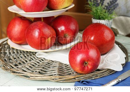 Tasty ripe apples on serving tray on table close up