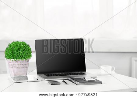 Modern workplace with laptop, close up
