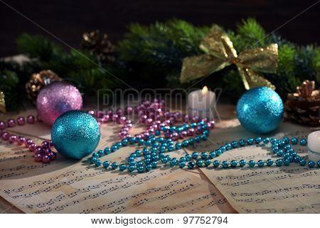 Christmas decorations on music sheets, closeup