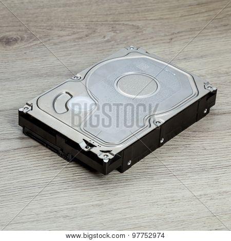harddisk on wood desk background.