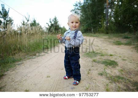little boy plays on the road