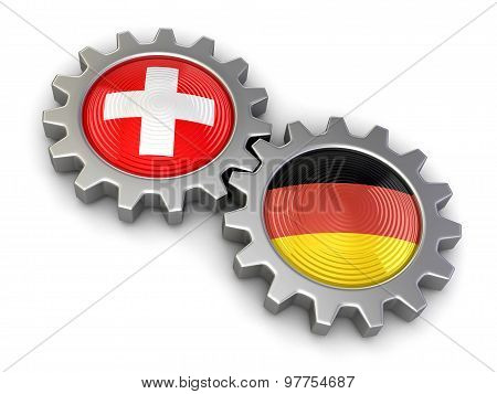 Swiss and German flags on a gears (clipping path included)