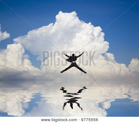 businessman jumping on the water