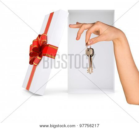 Open gift box with arm and keys on white