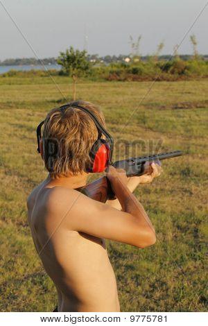 boy shooting skeet