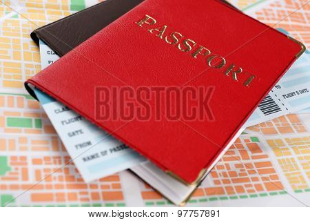 Passports with tickets on map background