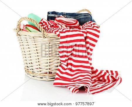 Colorful clothing in wicker basket isolated on white