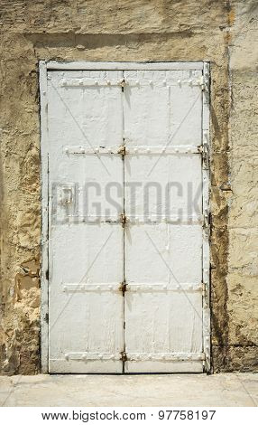 old white vintage door in a street in historical part of Valletta in Malta