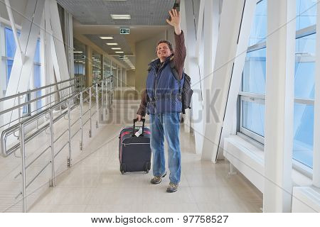 Men tourist with a suitcase at the airport