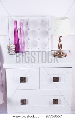 Table lamp on commode in room