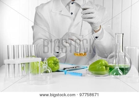 Scientist examines salad pepper in laboratory