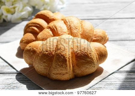 Delicious croissants on table close-up