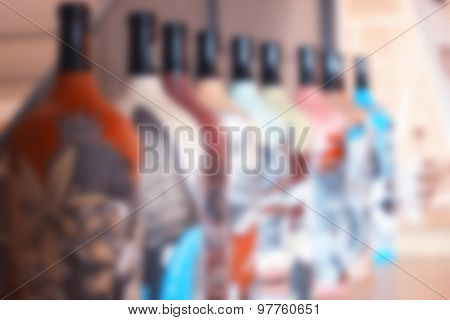 Colorful bottles of wine blurred background