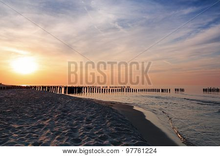 Sunset And Breakwaters On The Baltic Sea