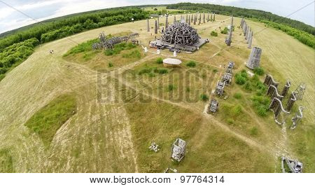 RUSSIA, NICOLA-LENIVETS - JUL 5, 2014: Tourists near art object Universal Mind during 9th International Festival of landscape objects Archstoyanie. Aerial view. (Photo with noise from action camera)