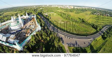 RUSSIA, MOSCOW - JUL 12, 2014: Panorama of renovation of New-Jerusalem Monastery and Christ Resurrection Cathedral at summer sunny day. Aerial view (Photo with noise from action camera)