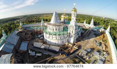 RUSSIA, MOSCOW -?? JUL 12, 2014: Complex of New-Jerusalem Monastery with Christ Resurrection Cathedral at summer sunny day. Aerial view (Photo with noise from action camera)