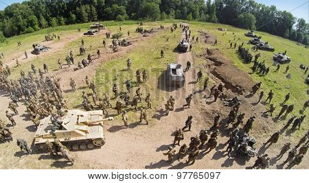 RUSSIA, NELIDOVO - JUL 12, 2014: Troops of Soviet and German armies on field after fight during reconstruction Battlefield at Second World war. Aerial view. (Photo with noise from action camera)