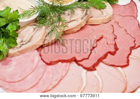 Group of thin sliced meat, ham and sauce