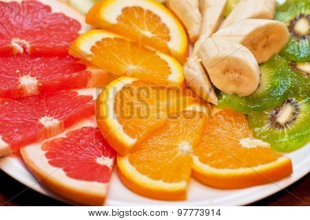 Slices of various fruits closeup photo