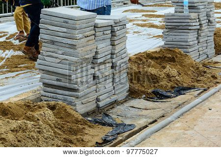 Construction Site Building Sidewalk Pavement With Stone Blocks