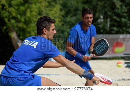MOSCOW, RUSSIA - JULY 17, 2015: Luca Carli (left) and Marco Garavini of Italy in the match of the ITF Beach Tennis World Team Championship against Germany. Italy won the match 3-0