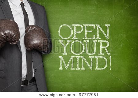 Open your mind on blackboard with businessman on side