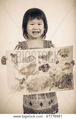 Asian Girl Showing Her Artwork, Studio Shot, Vintage Picture Style