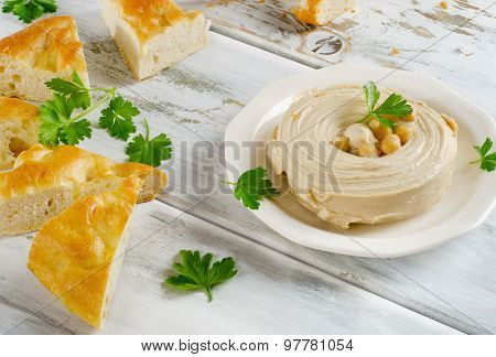 Plate Of A Healthy Homemade Creamy Hummus With Pita.