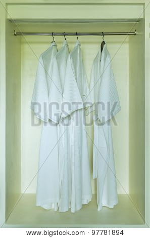 Dressing Gown Hanging In A White Wardrobe