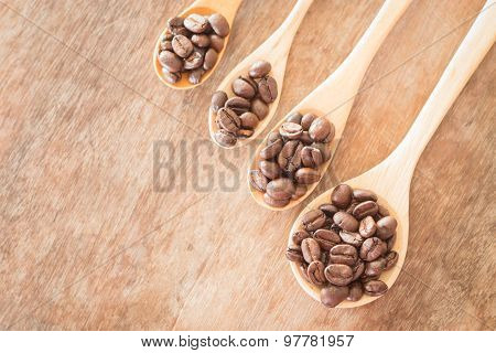 Coffee Spoons On Grunge Wooden Table