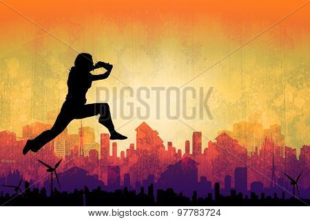 Businesswoman leaping against artistic cityscape design
