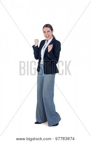 Portrait of a businesswoman cheering and yelling against a white background
