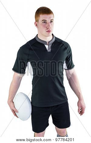 Rugby player holding a rugby ball on a white background