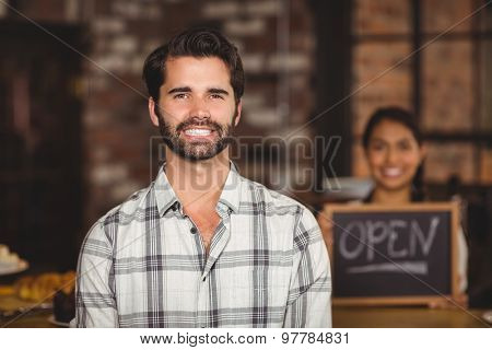 Portrait of a customer looking at the camera at the coffee shop
