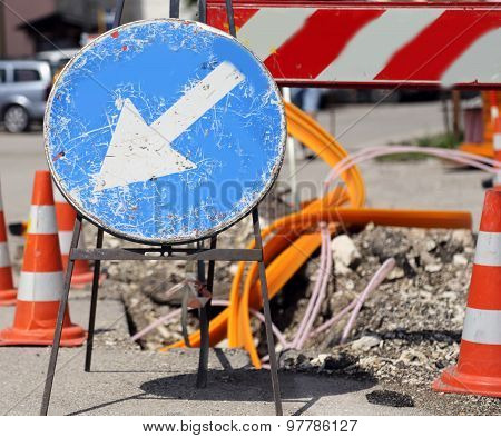 Road Sign With Arrow White Before Excavation For The Laying Of Telecommunications Infrastructure