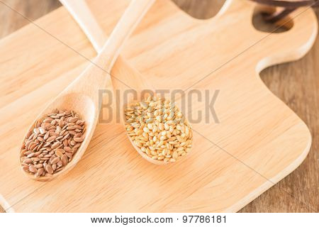 Spoon Of Flax Seed On Wooden Table