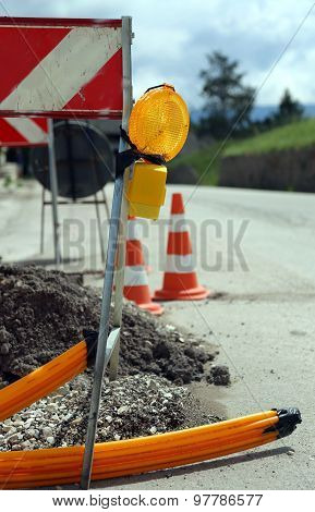 Lamp In Road Construction For Laying Telecommunications Infrastructure