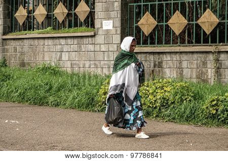 An Older Ethiopian Woman Walking On The Streets Of Addis
