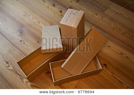 Empty Shoe Boxes On A Wooden Floor