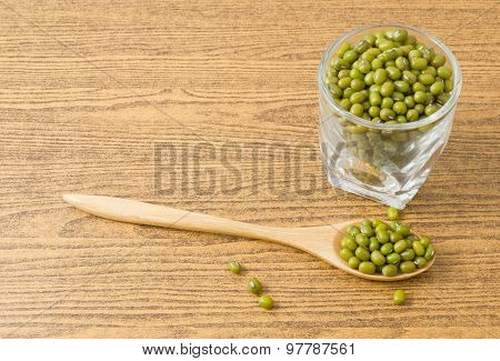 Mung Beans In Wooden Spoon And Glass Cup