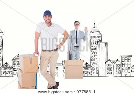 Happy delivery man leaning on trolley of boxes against hand drawn cityscape