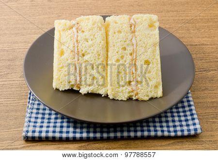 Triangle Vanilla Chiffon Cake On A White Dish