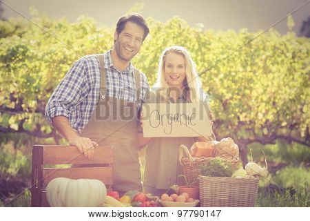Portrait of happy farmers couple over a table of organic products