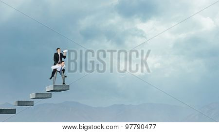 Businessman riding on back of his colleague