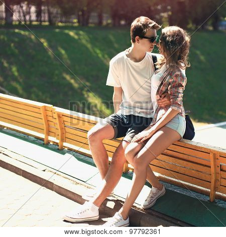 Portrait Of Young Couple Embracing Outdoors In Sunny Summer Day